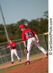Little league baseball pitcher looking at batter. - Little...