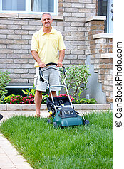 Senior man with lawn trimmer.