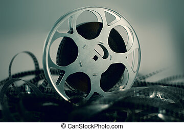 Film reel - with celluloid around green atmosphere