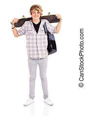 happy teen boy carrying skateboard