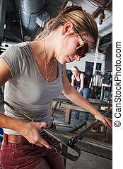 Sculptor Shaping Glass Art