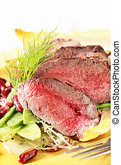Roast beef with vegetable garnish - Slices of roast beef...