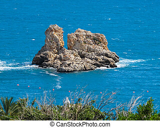 Turqouise sea in Sicily Italy with small island