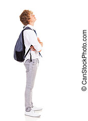 teen boy looking up - teen boy with backpack looking up