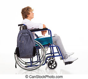 handicapped teen boy sitting on wheelchair