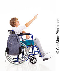 disabled boy sitting on wheelchair and pointing