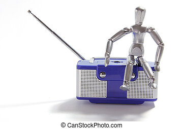 Miniature Figure and Transistor Radio on White Background