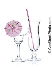 Cocktail glasses with drinking straw and umbrella. Isolated...