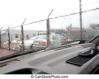 Driving a car in the rain front window with windscreen wiper