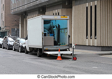 Moving van with loading ramp at London streets
