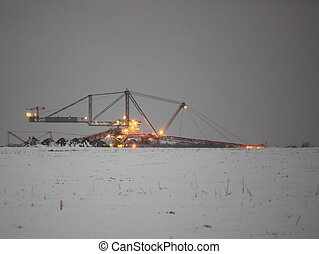 Giant excavator in a coal open pit evening - Bucket wheel...