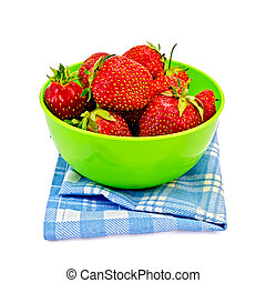 Strawberries in a green bowl with a napkin