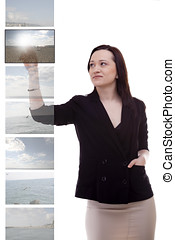 Businesswoman choosing holiday destination studio shot
