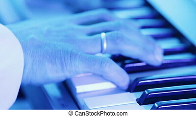 Playing keyboards - Man energetically playing electronic...