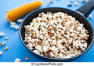 Delicious home cooking popcorn in a pan, closeup