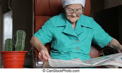 old woman reading newspaper - old woman reading and turn...