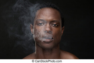African American Man with Smoke Coming Out Mouth - Portrait...