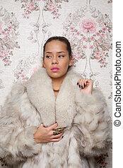 Portrait of a Beautiful Woman in Fur Coat