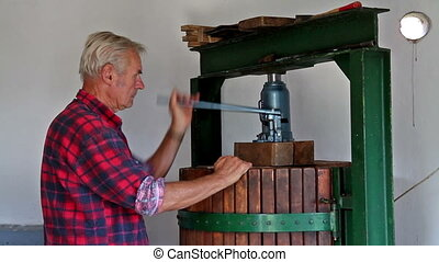 Farmer working with the wine press