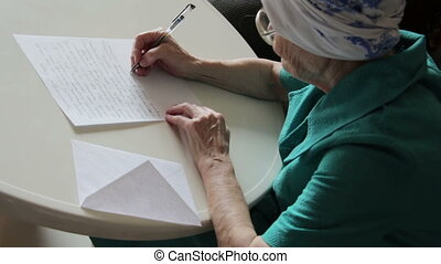 old woman writing letter