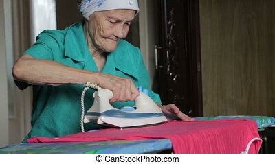 old woman ironing