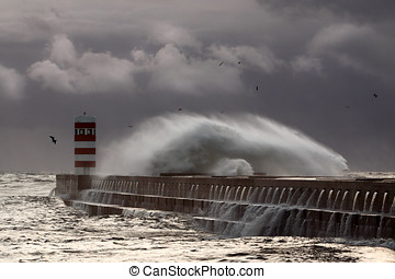 Windy waves - Stormy sunset at the harbor of the mouth of...