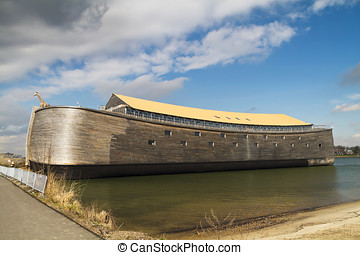 Full size wooden replica of Noah's Ark with yellow roof