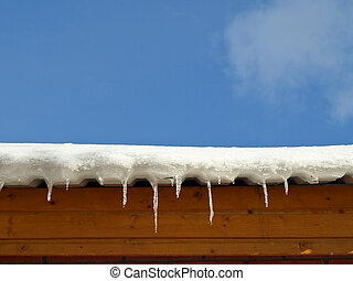 Snow with icicles on the roof