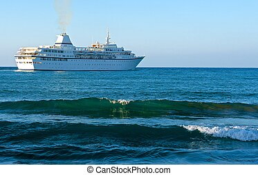 Cruise liner - Large cruise ship floating in the sea In the...