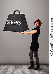Young woman holding one ton of stress weight - Attractive...