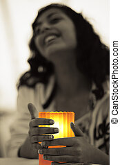Seeking Warmth - A girl seeking warmth from a lit candle