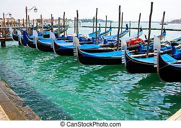 Gondola boats in Venice - Blue and black gondola boats...