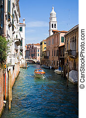 Nice Venice canal - A boat in a canal in Venice, Italy