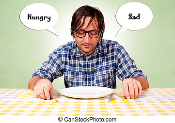Hungry and sad - Man sitting at the table hungry and sad