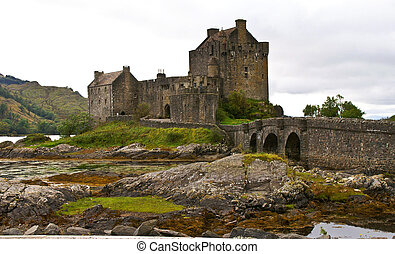 ancient castle - eilean donan castle on a cloudy day