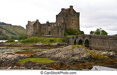 ancient castle    - eilean donan castle on a cloudy day