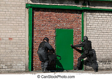 Subdivision anti-terrorist police during a black tactical...