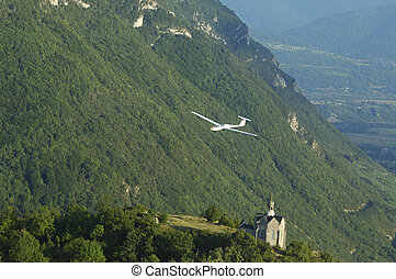 A glider flying over St Michel Church at Challes les eaux...