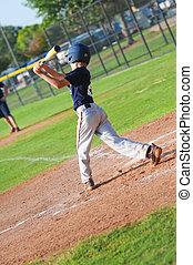 Pre-teen baseball player at bat - Preteen baseball player...