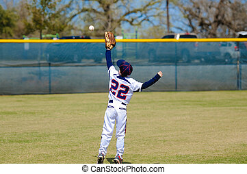 Youth outfielder catching ball - Youth outfield catching a...
