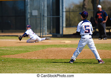 Youth pitcher after throw to first - Youth baseball pitcher...