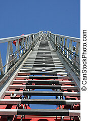 steps to Heaven by a fire truck with the autoscala in raised...