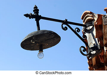 old lantern in Old Nessebar on blue - old forged lantern in...