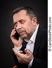 business man speaks on a mobile phone