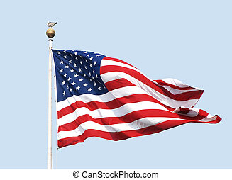 The American flag - the Stars and Stripes - flies on a sunny...