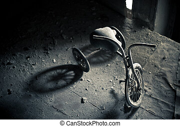 Abandoned tricycle - Old dusty tricycle standing on the...