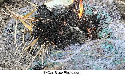 fishing net, fire, poaching