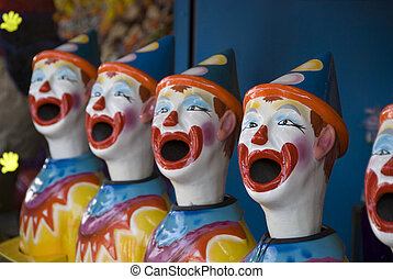Midway Clowns - Stock photo of a row of plastic clown heads...