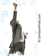 breakthrough - happy businessman with cellular phone and...