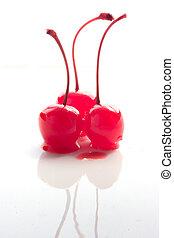 Maraschino Cherries on white shiny background